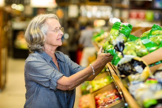 Senior woman buying vegetables