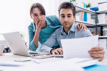 Couple checking bills at home