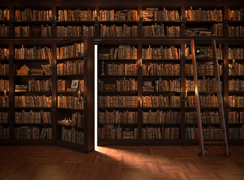 Secret door in the bookcase. Mysterious library with candle lighting. With vintage stuff.