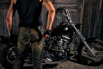 Young man with wrench, ready to repair his bike