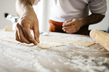 Step by step handmade ravioli on a wooden table. Series