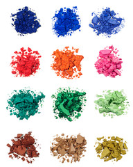 Top view of colorful crushed eye shadows isolated on white background