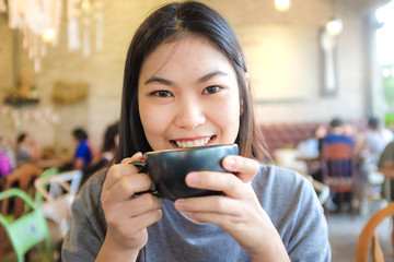 Woman smiling with coffee cup