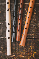 Set of flutes  on the wooden table vertical
