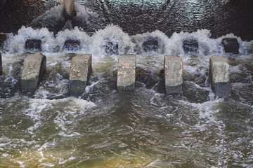 Turbulent  flow of water pass a weir after the rain