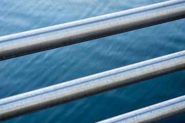 Railing by harbor