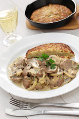 Zurich style veal stew and rosti potato, Swiss cuisine