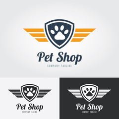 Pet shop logo template. Animal paw print Icon with shield and wings. Vector for pet shop, hotel, vet clinic.