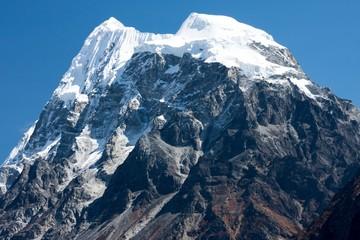 Fototapete - Summit of Mt. Langshisha Ri from Langtang Valley, Himalayas, Nepal