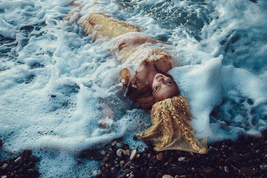 Mermaid in the ocean waves