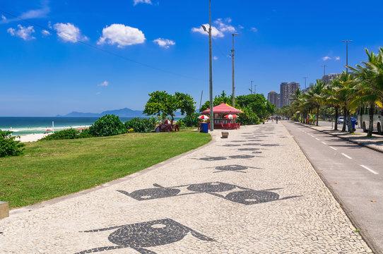 Barra da Tijuca beach with mosaic of sidewalk  in Rio de Janeiro. Brazil