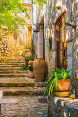 Wall Mural - Idyllic view of an mediterranean rustic house and stone stairs