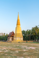 Golden pagoda with Old Buddhism church (Ubosot) in public temple, Thailand