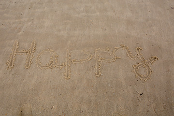 Happy writting in  a sand at summer