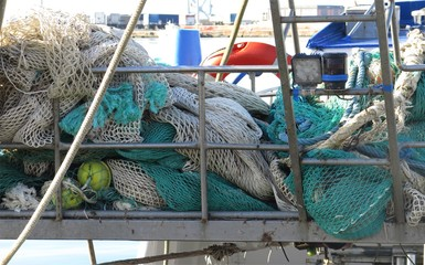 Messy fishing net on the boat