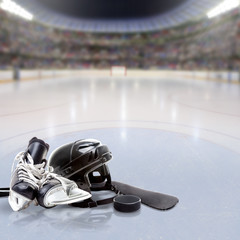 Dramatic Hockey Arena With Equipment on Reflective Ice and Copy Space. Deliberate focus on foreground equipment and shallow depth of field on background. Lighting flare effect.