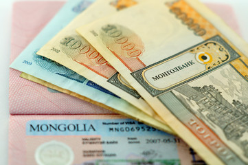 Visa in the passport to Mongolia and Mongolian banknotes
