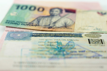 Visa in the passport to Indonesia and Indonesian banknote