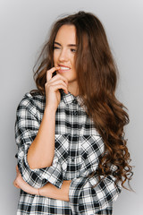 Portrait of cute teen girl wearing stylish shirt isolated on gray background fashion for teenagers