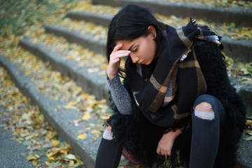 Depressed young woman outdoors