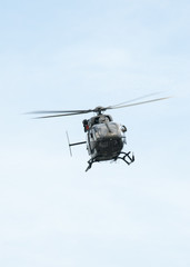 UH-72A Lakota flies over head with doors open