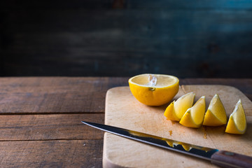 lemons cut on a cutting board