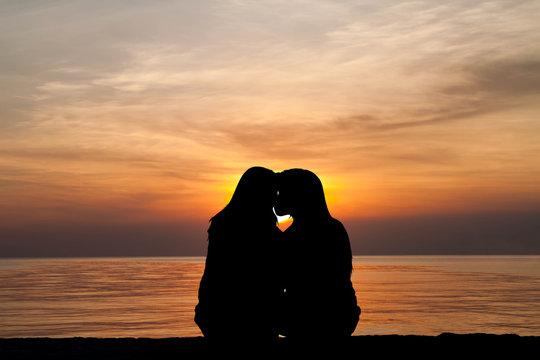 female homosexuals in love beside sea