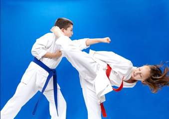 Children are training punch arm and roundhouse kick leg