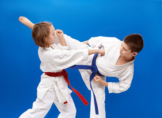 Young athletes train karate blows