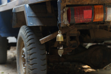 An old truck with brass bell at the rear.