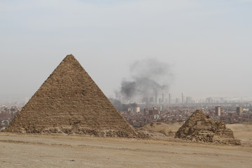 One of the Great Pyramids in Giza, Egypt, with Cairo in the background-shows the air pollution around the Cairo area