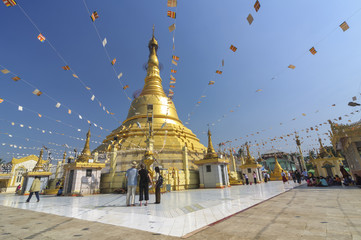 YANGON, MYANMAR – December 29 : Unidentified tourists at Botahtaung Pagoda on December, 2015, Yangon, Myanmar.