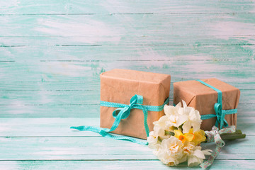 Festive present boxes  and flowers  on turquoise painted wooden