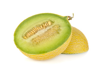 half cut galia melon with seeds on white background