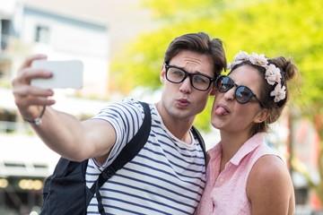 Hip couple taking selfie