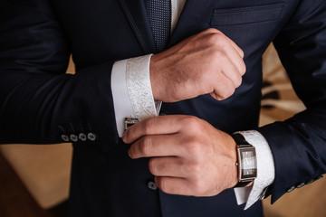 Mans hands with cufflinks. Elegant gentleman clother