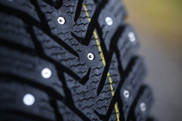Studded tire on a  background