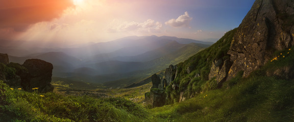 Panorama. Carpathian Mountains. View from Mount Pop Ivan. The rays of the setting sun