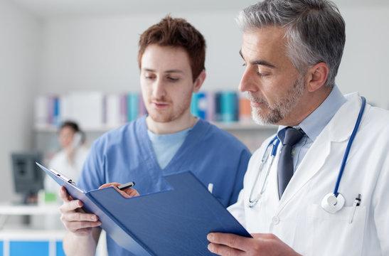 Doctors examining patient's medical records