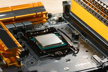 .Modern processor fitted with the PC motherboard with a cascade of power