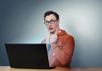 Programmer in glasses with laptop. Deep Fear