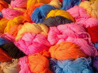 colorful tangles of wool yarn closeup. multicolored thread wool for knitting