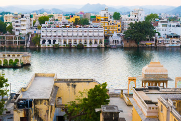 Udaipur cityscape, historical buildings and waters of lake Pichola