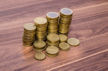 Golden Euro Coins Stack On Wooden Table