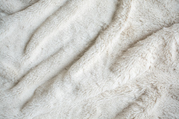 rippled white fur background and textile
