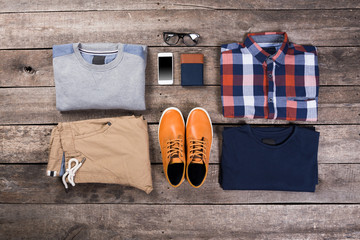 Men's clothes on wooden board