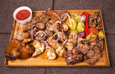 Mixed grilled various meat platter.