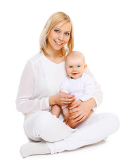 Happy smiling mother with baby sitting together on white backgro