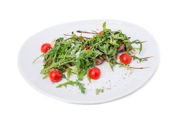 Warm beef shish kebab with fresh arugula.