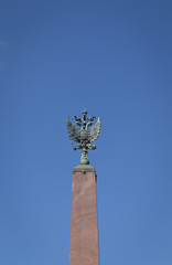 Statue of Double-Headed Eagle (The Emblem of Russia) against Blue Sky